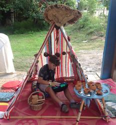 Young boy enjoying teepee. First in