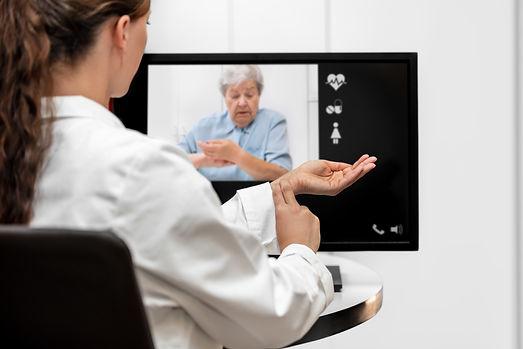 Brown Emergency Medicine doctor and seniorpatient receiving urgent telemedicine from Brown Emergency Medicine TeleCare.