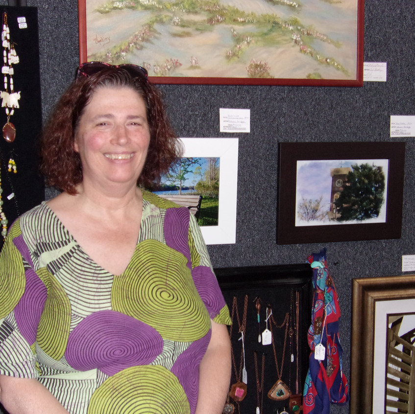 Debbie with some of her images
