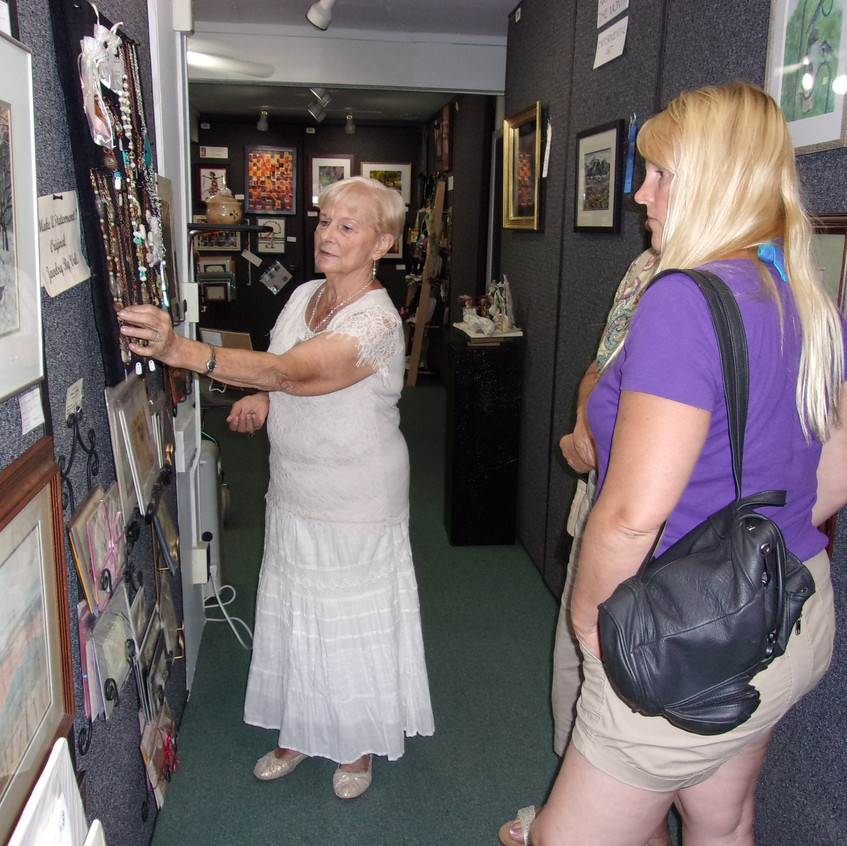 Val explains some of her work to guests