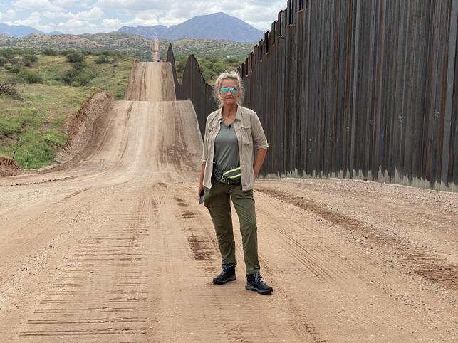 Ann Vandersteel at the border wall