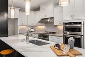 Marble Granite Quartz Countertops in Beautiful Remodeled Kitchen