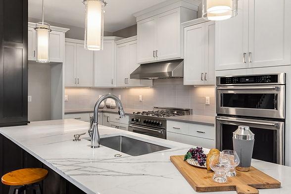 Beautiful Marble Quartz Granite Countertops in Kitchen with Hanging Pendant Lighting