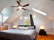 Lighting Ceiling Fans in Bedroom with Hardwood Floors