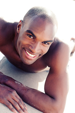 smiling male model on the beach