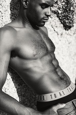 topless male model on beach