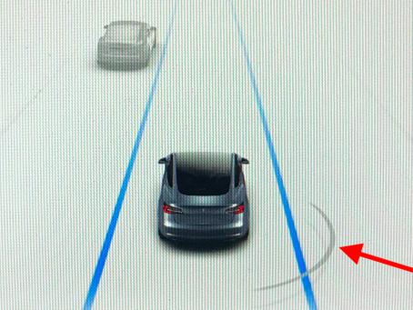 Tesla 軟體更新:                                     盲點警告和自動折疊側鏡