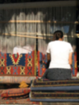Women weaving a carpet in Cappadocia, Tu