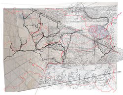 A complex, layered work somewhat resembling a map. Black, gray, and and red lines intersect with eac