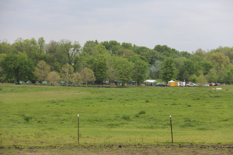 View of pasture and Boy Scouts camping at the pond