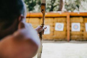 Man_aiming_bow_at_distance.jpg