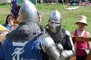 two men wearing silver armor facing each