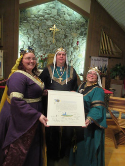Acre's King and Queen signing a treaty with the East Kingdom Queen