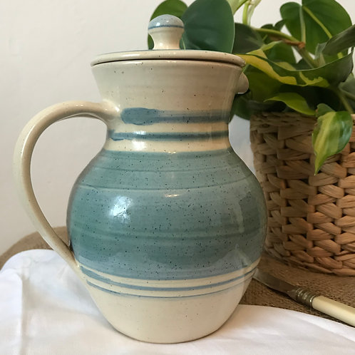 Pale blue and cream jug with lid
