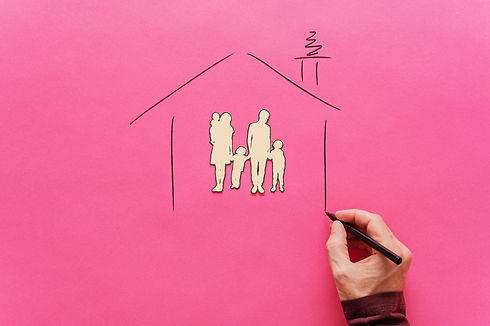 male-hand-drawing-house-shape-around-pap