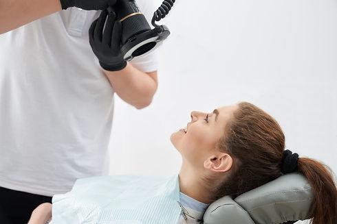 man-taking-photo-of-teeth-after-whitenin