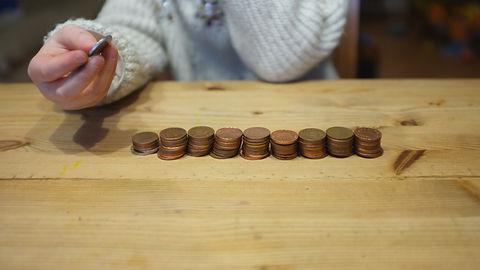 hands coins.jpg
