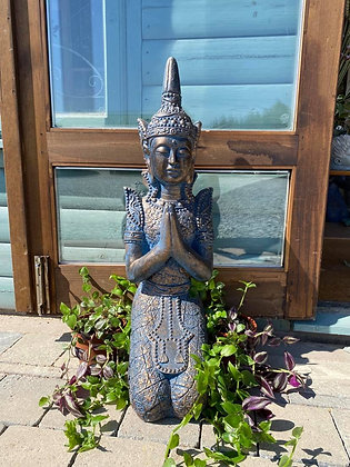 Blue kneeling buddha statue