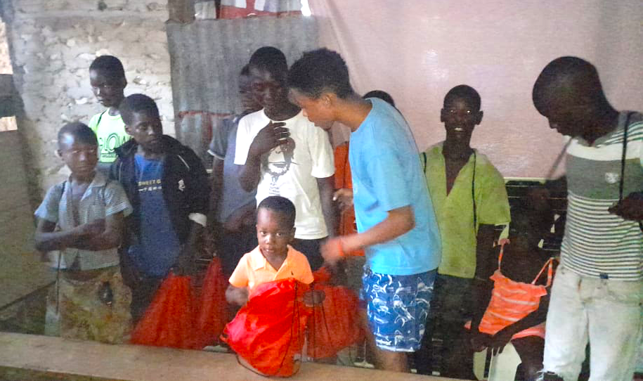 Haiti's south August 2021--orphans bringing homeless children food-kits from FEPE.png
