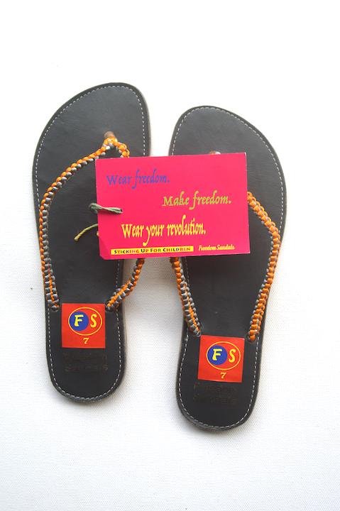 The Slide model, Orange & Gold on Black, size 7