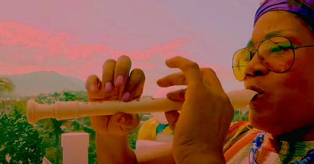 Manzè with recorder.png