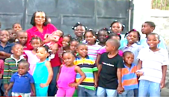 Marie-Jo and orphans outside FEPE circa