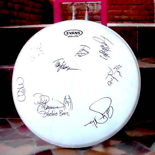 Drumhead signed by all eight Doobie Brothers