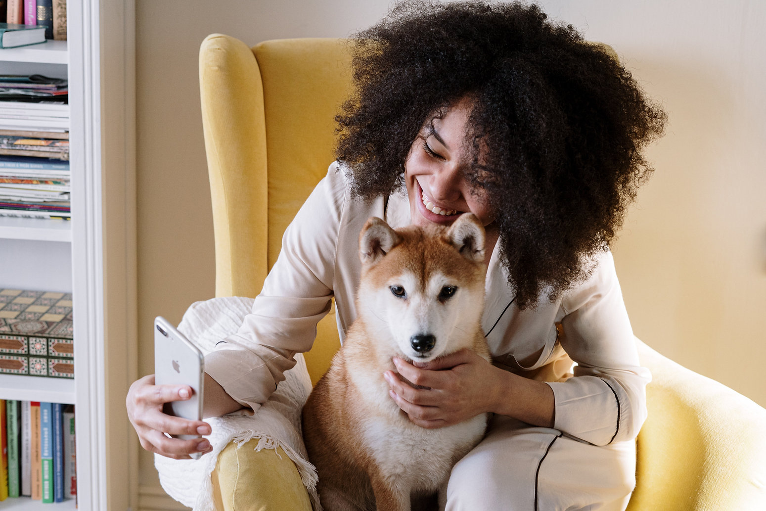 woman with smartphone, telemedicine Doctor veterinarian telehealth telemedicine veterinary care veterinarian help pet pets dog dogs puppy puppies cat cats kitten kittens horses companion animal vet nurse pet owner anipanion televet airvet petriage software subscription clinic hospital virtual visit