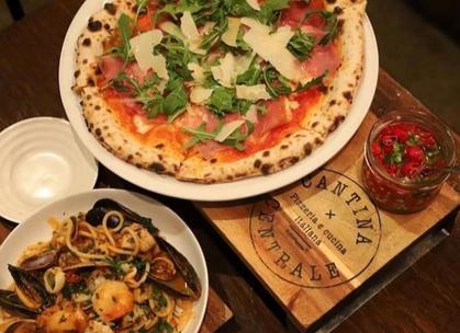 Prosciutto pizza and seafood pasta