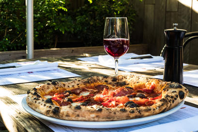Nothing better then a Pizza and a glass of Wine uder the sun