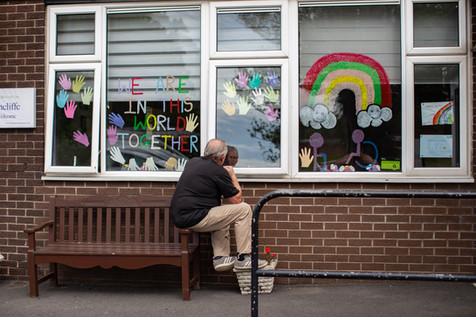 A son talks to his father through the window at Aintree care home, Wigan.