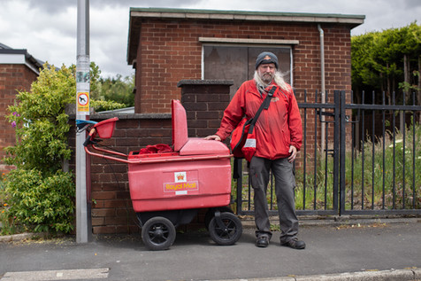 A Postman (key worker) stops for a picture, Chorley.
