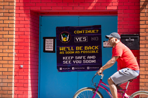 A cyclist rides past a nightclub poster, Wigan.