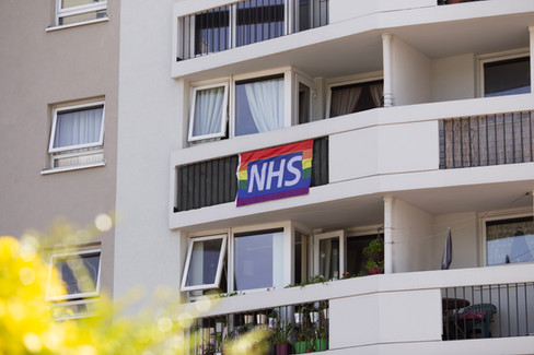 An NHS flag outside a block of flats, Wigan.