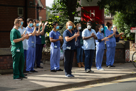 Staff at Wigan Hospital clap outside the hospital on a Thursday.