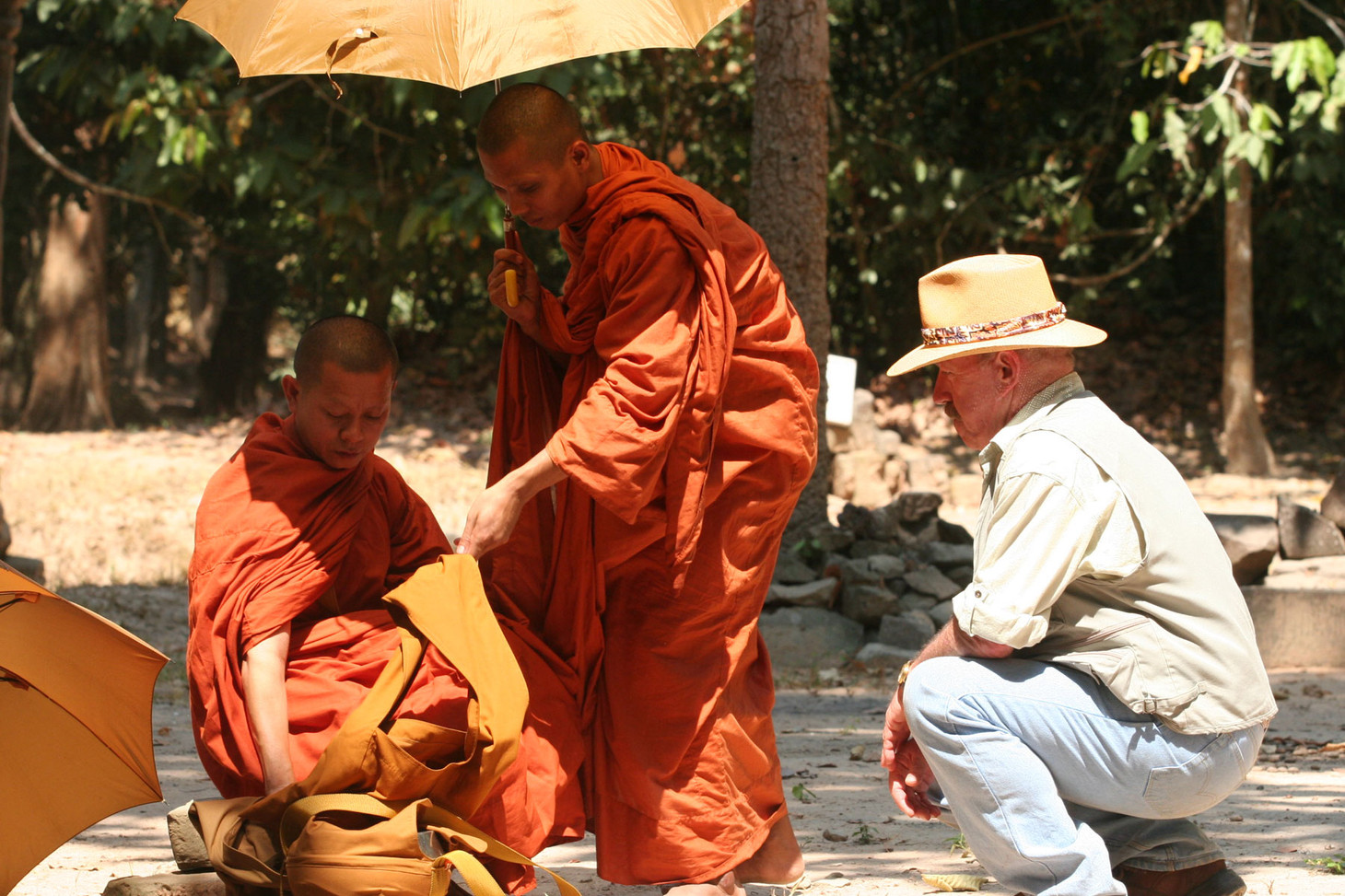 Interacting with buddist in Cambodia for my tv show 'Splash of Color' shown on Discovery channel.