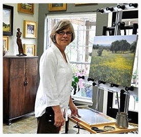 Fran Ellisor painting in ther studio.