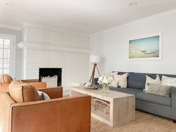 neutral-living-room-white-brick-fireplac
