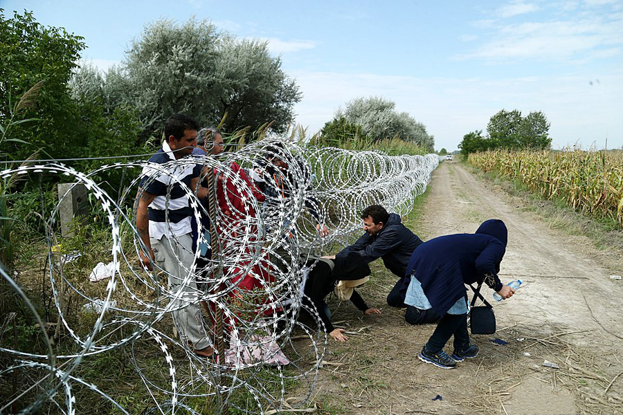 Migrants entering Hungary under the unfinished Hungary-Serbia border barrier, August 2015. Photo source: Wikimedia commons