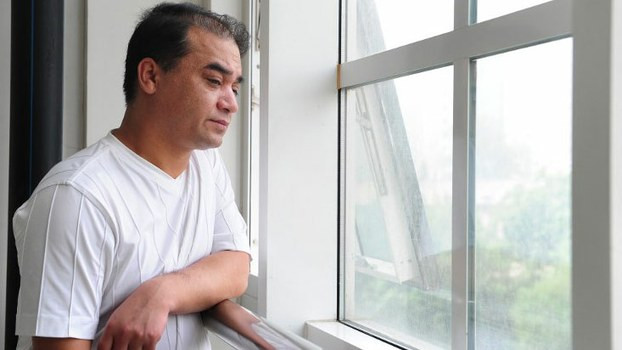 University economics professor Ilham Tohti, who was charged with promoting ethnic separatism and was handed a life sentence by a Chinese court on Sept. 23, 2014, in a file photo.