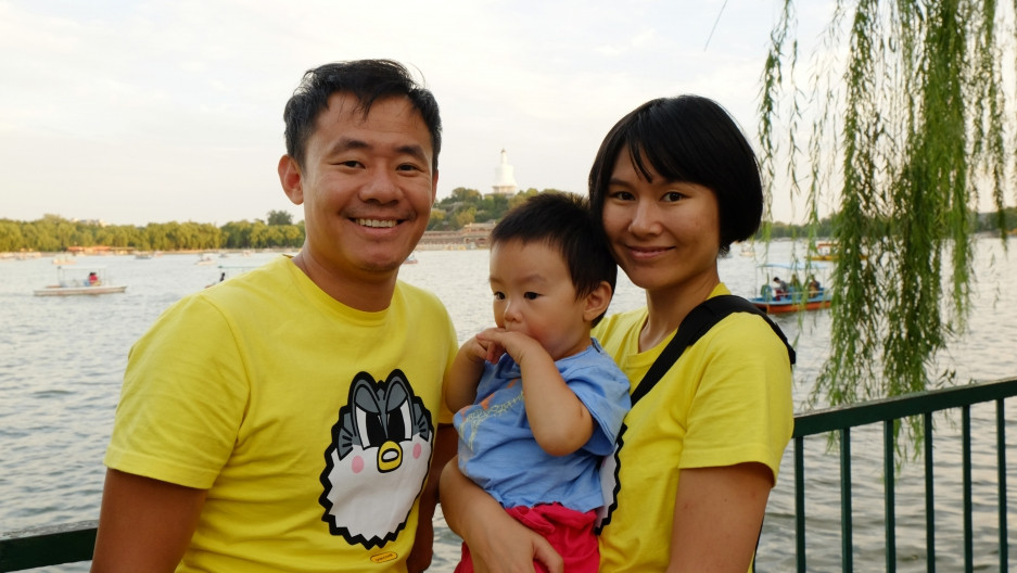 Xiyue Wang, a Princeton graduate student who is serving a 10-year prison sentence in Iran, with his wife, Qu Hua, and their son.