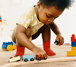 gender neutral child playing with trains
