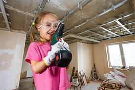 Little girl with power drill defying gender stereotypes