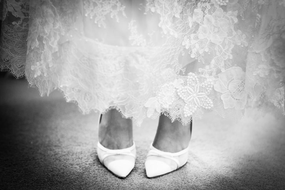 B&W of bride's shoes