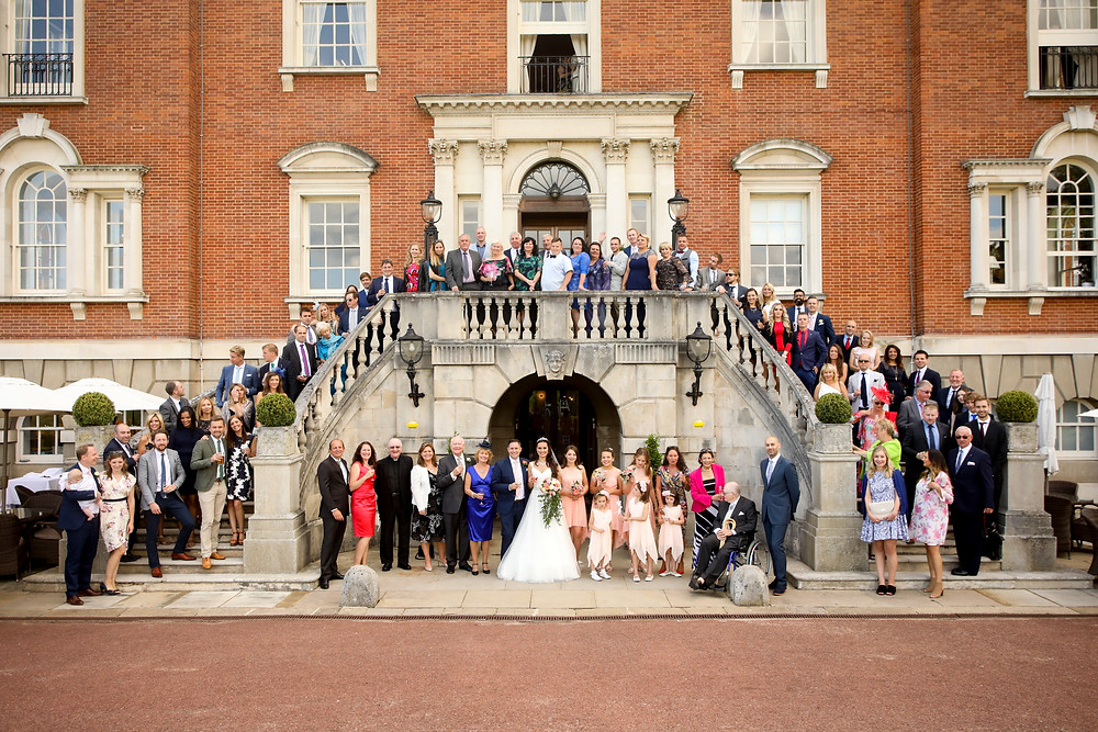 Large group shot on stairs at Woodcote Park