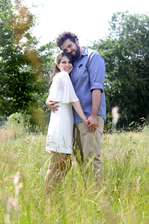 Portrait of Bride and Groom in Meadow