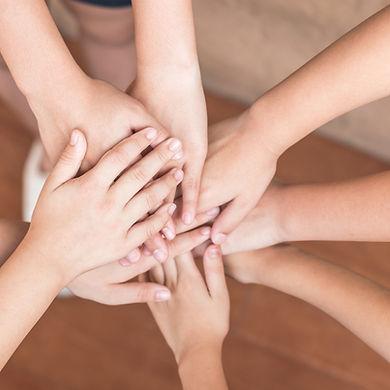 School kid volunteer's hands for public