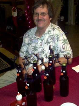 """Beer bottles decorated for the theme, """"Santa's reindeer."""""""