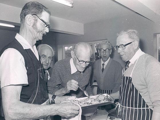 digital photo scan in black and white (b&w) of elderly men baking