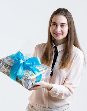 Digital photo scanning as a gift to celebrate a special birthday or anniversary. Girl giving photo gift